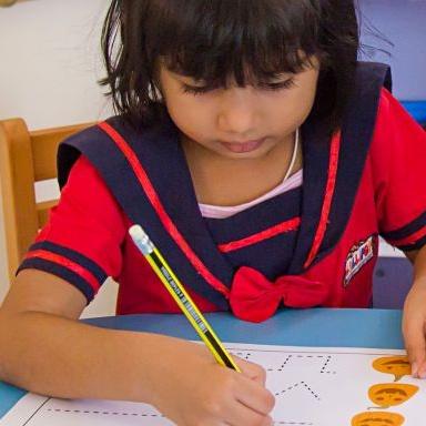 Learning to write at the best nursery in Sharjah, Lollipop Nursery
